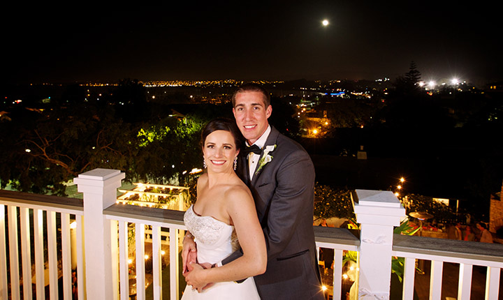 Perry House couple with Monterey City Lights in Background